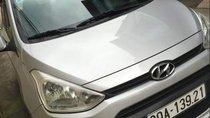 Gia đình bán xe Hyundai Grand i10 sản xuất 2014, màu bạc, xe nhập