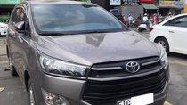 Cần bán gấp xe Toyota Innova 3/2017 màu xám ghi