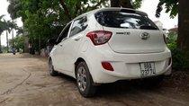 Cần bán xe Hyundai Grand i10 sản xuất 2014, màu trắng, nhập khẩu