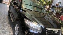Cần bán xe Hyundai Santa Fe năm sản xuất 2011, màu đen, xe sử dụng gia đình