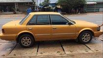 Cần bán lại xe Nissan Bluebird Blu 2.0 năm 1989, màu vàng
