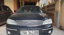 Cần bán xe Ford Laser Sx 2005, xe gia đình, màu đen, nội thất màu kem