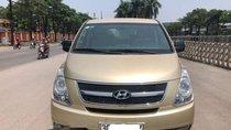 Bán gấp Hyundai Grand Starex nhập khẩu Hàn Quốc đời 2010, bản 9 chỗ ngồi, màu vàng cát, số sàn