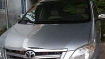 Cần bán xe Toyota Innova 2.0E đời 2014, màu bạc
