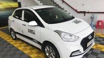 Bán Hyundai Grand i10 1.2AT sedan, màu trắng, số tự động, sản xuất 2018, đi 8000km