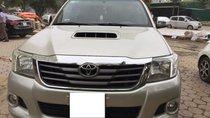 Cần bán Toyota Hilux 2014, máy dầu, số sàn, màu bạc, 2 cầu, nhập Thái Lan