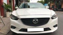 Gia đình cần bán Mazda 6 sản xuất 2016, số tự động, bản 2.0, màu trắng