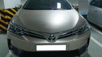 Bán Toyota Corolla Altis 1.8E AT màu vàng, sản xuất và đăng ký 12/2018, biển Hà Nội