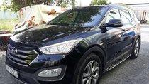 Bán Hyundai SantaFe 4WD 2.4AT màu đen VIP, máy xăng, bản full 2 cầu, số tự động, sản xuất 2015, biển Sài Gòn