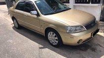 Cần bán lại xe Ford Laser 1.8 AT đời 2003, màu vàng, máy móc còn zin 100%