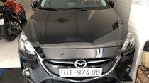Bán Mazda 2 Sedan 1.5AT màu đen VIP số tự động sản xuất 2016, biển Sài Gòn, đi 15000km