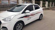 Bán xe Hyundai Grand i10 Sedan 1.2, số sàn, mâm sắt, sản xuất 2018 màu trắng tinh