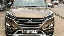 Cần bán xe Hyundai Tucson Full máy dầu đời 2017, màu nâu