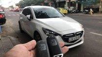 Bán ô tô Mazda 2 năm 2016, màu trắng, xe đang hoạt động bình thường