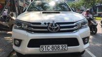 Cần bán lại xe Toyota Hilux 3.0AT năm 2016, màu trắng, giá chỉ 670 triệu