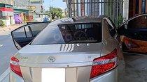 Bán xe Toyota Vios J sản xuất năm 2015, màu vàng, ít sử dụng