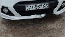 Bán ô tô Hyundai Grand i10 đời 2014, màu trắng, xe nhập số sàn giá cạnh tranh