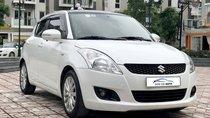 Bán ô tô Suzuki Swift 1.4AT 2014, màu trắng - Nội thất như mới
