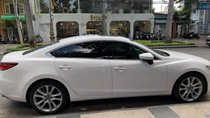 Bán Mazda 6 2.0 sản xuất năm 2014, màu trắng xe gia đình, giá 700tr