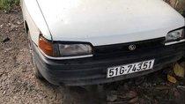 Bán Mazda 323 đời 1996 màu trắng, máy còn chạy ngon