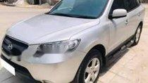 Cần bán lại xe Hyundai Santa Fe đời 2009, màu bạc số sàn