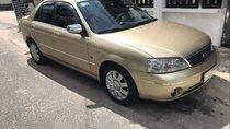 Gia đình bán xe Ford Laser 1.8 Ghia sản xuất 2003, màu vàng cát
