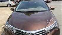 Chính chủ bán Toyota Corolla altis 2015, màu nâu, giá 625tr