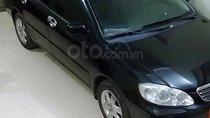 Cần bán Toyota Corolla Altis năm 2004, màu đen xe gia đình, 265tr