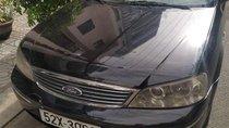 Chính chủ bán ô tô Ford Laser đời 2004, màu đen