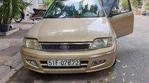 Bán xe Ford Laser Deluxe 1.6 MT đời 2002, màu vàng cát, 260 triệu
