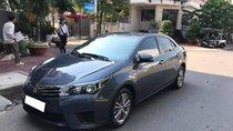 Cần tiền bán xe ô tô Altis 2015, số sàn, màu xanh