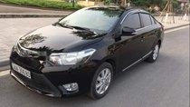 Cần bán gấp Toyota Vios E sản xuất 2014, màu đen xe gia đình