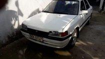 Bán Mazda 323 năm sản xuất 1996, màu trắng, nhập khẩu nguyên chiếc