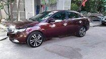 Cần bán gấp Kia Forte sản xuất 2011, màu đỏ xe gia đình