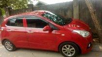 Gia đình cần bán Hyundai Grand i10 đời 2015 nhập khẩu Ấn Độ, xe màu đỏ