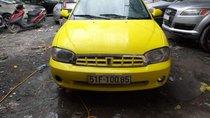 Cần bán Kia Spectra 2004, màu vàng, xe nhập