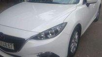 Cần bán gấp Mazda 3 HB đời 2016, màu trắng, đăng ký lần đầu 2016