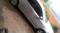 Cần bán xe Daewoo Lacetti MT 2010, màu bạc, xe gia đình