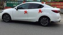 Cần bán Mazda 2 AT sản xuất 2017, màu trắng, xe nhà mình mua mới 7/2017