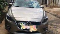 Cần bán xe Mazda 3 2015, màu vàng, nhập khẩu xe gia đình
