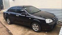 Cần bán lại xe Daewoo Lacetti 2010, màu đen