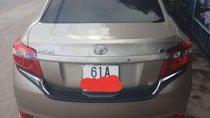 Bán Toyota Vios E 1.5AT năm sản xuất 2017, màu vàng