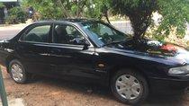 Cần bán xe Mazda 626 LX năm sản xuất 1997, màu đen