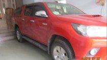 Bán Toyota Hilux 3.0G đời 2016, màu đỏ, số sàn
