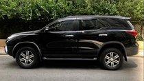 Bán Toyota Fortuner năm 2017, màu đen, xe còn mới 99%