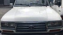 Bán Toyota Land Cruiser sản xuất 1996, màu trắng, nhập khẩu, 7 chỗ