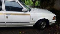 Cần bán gấp Toyota Corolla altis năm sản xuất 1985, màu trắng, nhập khẩu nguyên chiếc, giá cạnh tranh