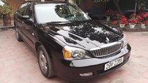 Cần bán Daewoo Magnus đời 2004, màu đen, giá 119tr