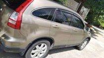 Cần bán xe Honda CR V đời 2009, màu vàng cát