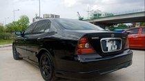 Bán Daewoo Magnus năm sản xuất 2004, màu đen, xe nhập